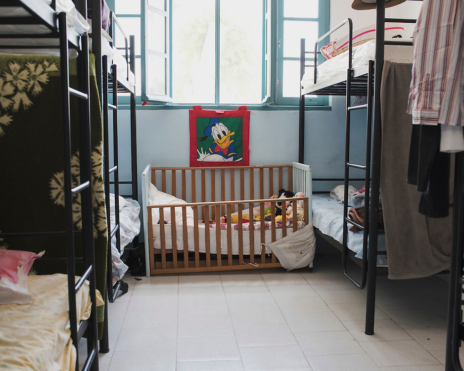 Bunkbeds and a child's cot at PIKPA, a refuge opened in January 2016 by the Leros Solidarity Network as a shelter for families and unaccompanied minors.