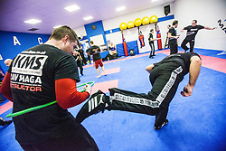 Students kicking under the area of the hoop, Stef Noij, KMG Instructor from the Institute Krav Maga Netherlands, at the IKMS G Level Programme seminar today at the Scottish Martial Arts Centre, Alloa.