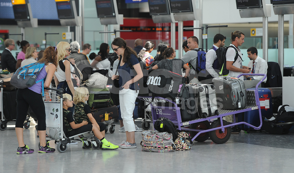 Singer Gwen Stefani, Gavin Rossdale and their three boys Kingston Rossdale, Zuma Nesta Rock Rossdale, Apollo Bowie Flynn Rossdale at Heathrow airport in London, UK. 24/07/2014<br />BYLINE MUST READ : GOTCHAIMAGES.COM<br /><br />Copyright by &copy; Gotcha Images Ltd. All rights reserved.<br />Usage of this image is conditional upon the acceptance <br />of Gotcha Images Ltd, terms and conditions available at<br />www.gotchaimages.com
