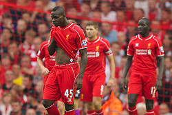 13.09.2014, Anfield, Liverpool, ENG, Premier League, FC Liverpool vs Aston Villa, 4. Runde, im Bild Liverpool's Mario Balotelli looks dejected as Aston Villa score the opening goal // during the English Premier League 4th round match between Liverpool FC and Aston Villa at the Anfield in Liverpool, Great Britain on 2014/09/13. EXPA Pictures © 2014, PhotoCredit: EXPA/ Propagandaphoto/ David Rawcliffe<br /> <br /> *****ATTENTION - OUT of ENG, GBR*****