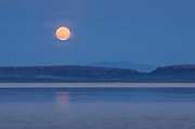 Full moon setting over Alvord Lake, a seasonal shallow alkali lake in Harney County, Oregon