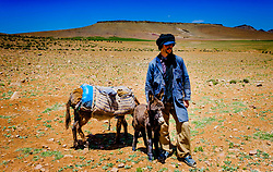 A shepherd with his donkeys looking after a flock of goats and sheep in the Atlas Mountains, MOrocco<br /> <br /> (c) Andrew Wilson | Edinburgh Elite media
