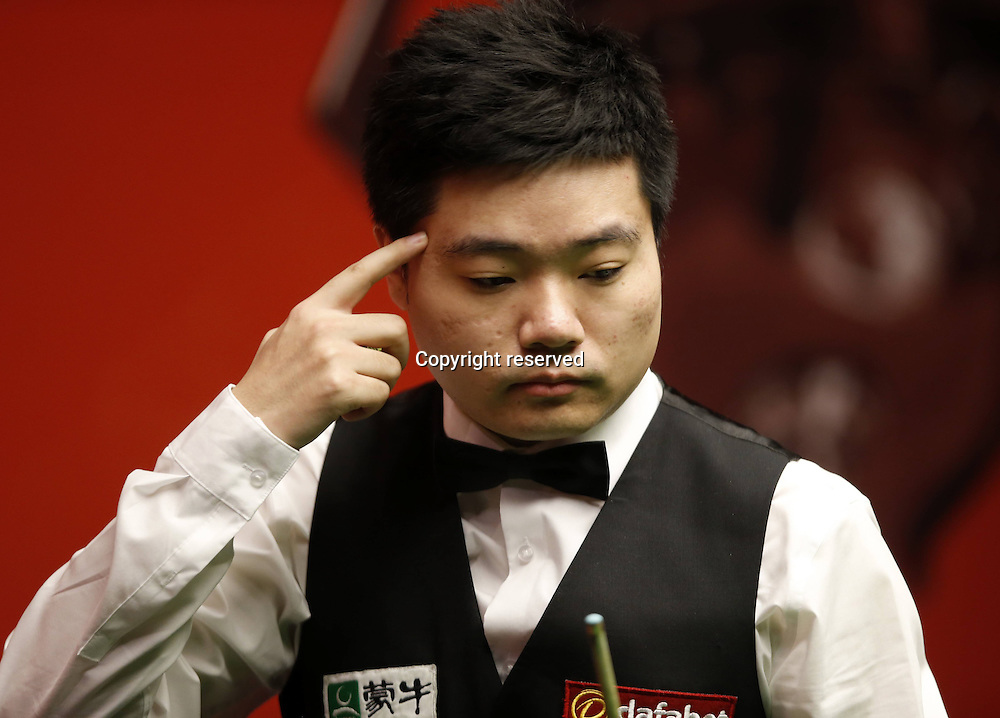 21.04.2014. Sheffield, England. Ding Junhui of China looks on during his round one match against  Michael Wasley (Eng) on Day 2 of World Snooker Championship at the Crucible Theater in Sheffield, Britain, April 20, 2014.
