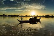 29 JUNE 2013 - PHNOM PENH, CAMBODIA:   Fishing boats on the Tonle Sap River in Phnom Penh, Cambodia.    PHOTO BY JACK KURTZ