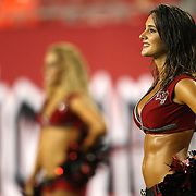 Tampa Bay cheerleaders watch from the sidelines during an NFL football game between the New England Patriots and the Tampa Bay Buccaneers at Raymond James Stadium on Thursday, August 18, 2011 in Tampa, Florida.   (Photo/Alex Menendez)