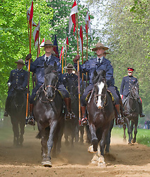 Picture shows Captain Richard Chambers (right), Riding Master of The Household Cavalry training The Royal Canadian Mounted Police in Hyde Park, London. 22/05/2012.<br /> <br /> In the run up to the Jubilee, The Queen has invited the Canadian Mounties to act as her personal body guard.<br /> Re-enacting a gesture made by her father King George VI in 1936, The Queen has seen fit to celebrate the Commonwealth by inviting the Royal Canadian Mounted Police to&nbsp;take part in British ceremonial this summer.<br /> A strong relationship between the Royal Family and the Mounties was forged in 1904 when The Queen's grandfather, King Edward VII, granted the Canadian Mounted Police the prefix 'Royal' in recognition of the Force's many services to Canada and the Empire.<br /> On Wednesday 23 May, fifteen men and horses from the Royal Canadian Mounted Police will ride down the Mall for the 11 o'clock Changing of the Queen&rsquo;s Life Guard ceremony with the Household Cavalry.<br /> After special training by members of the Household Cavalry riding staff, the Mounties will be performing the centuries&rsquo; old tradition for real on Wednesday and Friday next week. <br /> 2012.<br /> Picture by Trooper Mark Larner, RY.