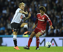 Diego Fabbrini of Middlesbrough fouls Johnny Russell of Derby County and is later given a yellow card - Mandatory byline: Dougie Allward/JMP - 07966386802 - 18/08/2015 - FOOTBALL - iPro Stadium -Derby,England - Derby County v Middlesbrough - Sky Bet Championship