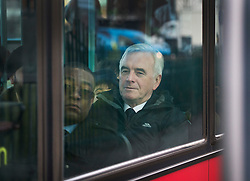 © Licensed to London News Pictures. 16/03/2016. London, UK.  Labour Shadow Chancellor John McDonnell travels by bus as he heads for Parliament on Budget day. Later Chancellor George Osborne will deliver his eighth budget to MPs.  Photo credit: Peter Macdiarmid/LNP
