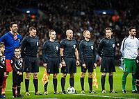 LONDON, ENGLAND - MARCH 07: Gianluigi Buffon (1) of Juventus, (1) Hugo Lloris of Tottenham Hotspur <br /> Referee<br /> Szymon Marciniak (POL)<br /> Assistant referees<br /> Paweł Sokolnicki (POL)<br /> Tomasz Listkiewicz (POL)<br /> Additional assistant referees<br /> Paweł Raczkowski (POL)<br /> Tomasz Musiał (POL) and (1) Hugo Lloris of Tottenham Hotspur during the UEFA Champions League Round of 16 Second Leg match between Tottenham Hotspur and Juventus at Wembley Stadium on March 7, 2018 in London, United Kingdom. (Photo by MB Media/  )