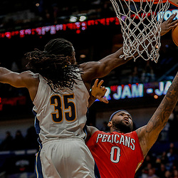 Dec 6, 2017; New Orleans, LA, USA; Denver Nuggets forward Kenneth Faried (35) blocks a shot by New Orleans Pelicans center DeMarcus Cousins (0) during the second half at the Smoothie King Center. The Pelicans defeated the Nuggets 123-114. Mandatory Credit: Derick E. Hingle-USA TODAY Sports