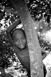 BANGLADESH DINAJPUR OCT94 - A young boy peeks from behind a tree in rural Dinajpur, northern Bangladesh...The Bangladesh Bureau of Statistics estimates the total working child population between 5 and 17 years old to be at 7.9 million...jre/Photo by Jiri Rezac..© Jiri Rezac 1994