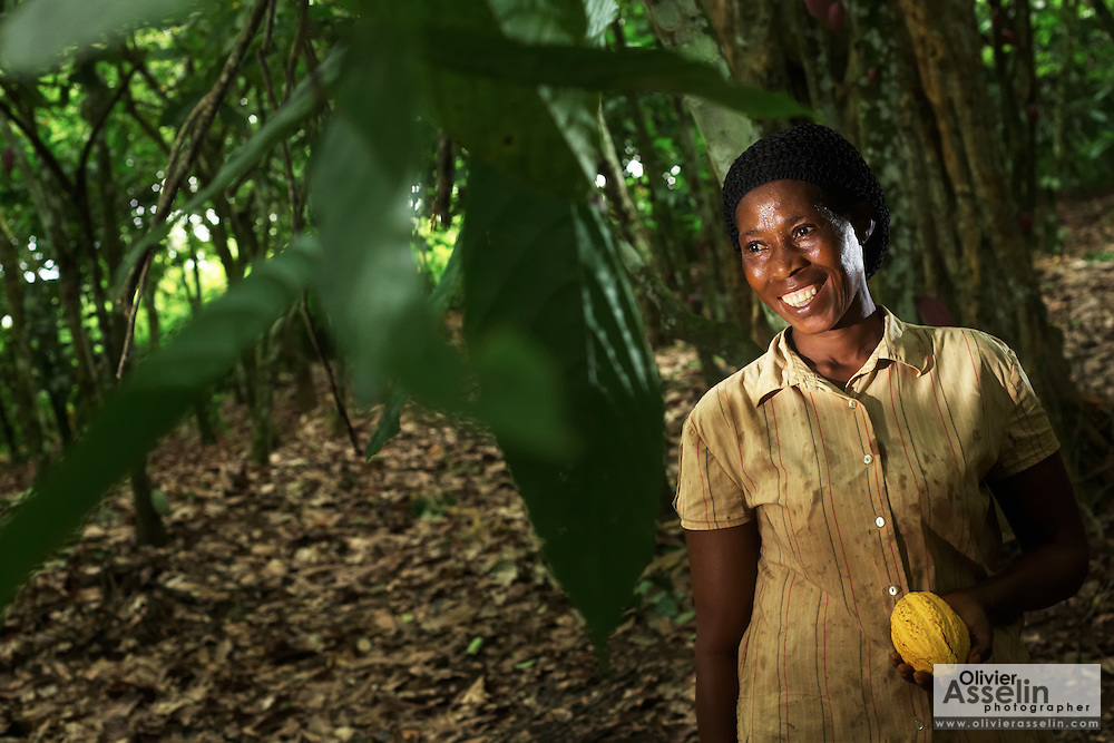 Cocoa farmer Comfort Kumeah poses for a portrait on a cocoa plantation near the town of Nem, Ghana on Thursday August 17, 2007.
