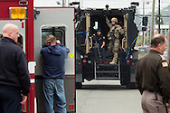(Gabe Green   The Daily World)<br /> <br /> Officers with the Aberdeen Regional Crisis Response Team ride in the back of an armored truck toward the house on the 600 block of Oak Street in Aberdeen where an armed woman barricaded herself on Friday after a body was found on the property.