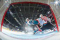 KELOWNA, CANADA - JANUARY 18: Cal Foote #25 clears the zone in front of Michael Herringer #30 of the Kelowna Rockets against the Moose Jaw Warriors on January 18, 2017 at Prospera Place in Kelowna, British Columbia, Canada.  (Photo by Marissa Baecker/Shoot the Breeze)  *** Local Caption ***