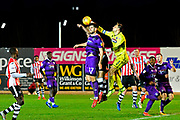 James McKeown (1) of Grimsby Town punches the ball clear during the EFL Sky Bet League 2 match between Exeter City and Grimsby Town FC at St James' Park, Exeter, England on 29 December 2018.