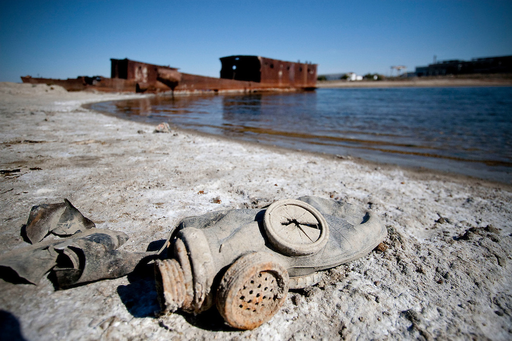 An abandoned gass mask remains on the bottom of salt covered Aral sea in Aralsk, Kazakhstan. The land around the Aral Sea is heavily polluted because of  the results of weapons testing, industrial projects, pesticides and fertilizer.