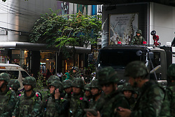 © Licensed to London News Pictures. 26/05/2014. Thai army form a line with a water cannon truck behind them during a Anti-Coup protest in Bangkok Thailand. Today Thailand's King formally approved Thai army chief General Prayut Chan-O-Cha as head of the nation's new military junta.  Photo credit : Asanka Brendon Ratnayake/LNP