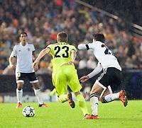 Valencia's Santi Mina and KAA Gent's Lasse Nielsen during Champions league match. October 20, 2015. (ALTERPHOTOS/Javier Comos)