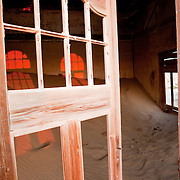 Early morning light through the broken windows of an abandoned home, Kolmanskop, Namibia
