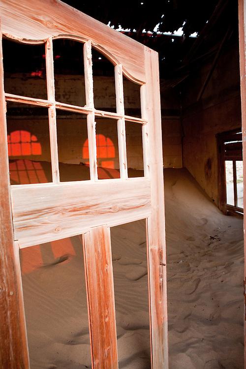 Early morning light through the broken windows of an abandoned home, Kolmanskop, Namibia