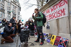 London, UK. 12th January, 2019. A speaker from Extinction Rebellion addresses supporters of Brazilian Women Against Fascism and Ele Não Students London demonstrating outside the Brazilian embassy in solidarity with women, students, environmental campaigners, black communities, LGBTQIA+ communities, indigenous peoples, peasants and workers protesting in Brazil following the inauguration of President Jair Bolsonaro.