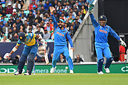 MS Dhoni (IND) and Shekhar Dhawan (IND appeal for LBW during the ICC Champions Trophy match between India and Sri Lanka at the Oval, London, United Kingdom on 8 June 2017. Photo by Jon Bromley.