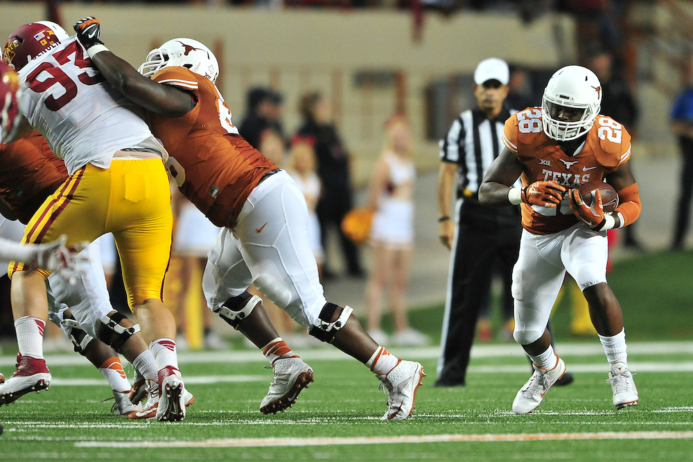 AUSTIN, TX - OCTOBER 18:  Malcolm Brown #28 of the Texas Longhorns breaks free against the Iowa State Cyclones on October 18, 2014 at Darrell K Royal-Texas Memorial Stadium in Austin, Texas.  (Photo by Cooper Neill/Getty Images) *** Local Caption *** Malcolm Brown