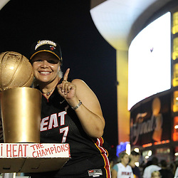 Jun 21, 2012; Miami, FL, USA; Miami Heat fan Lilliam Garcia from Puerto Rico celebrates outside the American Airlines Arena after the Miami Heat won the 2012 NBA championship. Miami won 121-106. Mandatory Credit: Derick E. Hingle-US PRESSWIRE