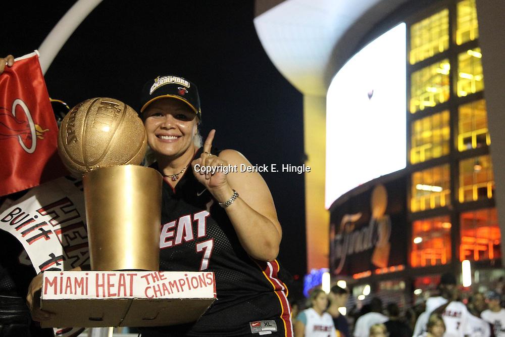 Jun 21, 2012; Miami, FL, USA; Miami Heat fan Lilliam Garcia from Puerto Rico celebrates outside the American Airlines Arena after the Miami Heat won the 2012 NBA championship. Miami won 121-106. Mandatory Credit: Derick E. Hingle-US PRESSWIRE