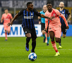 November 7, 2018 - Milan, Italy - Kwadwo Asamoah (L) of Inter Milan and Ousmane Dembele of Barcelona vie for the ballduring the Group B match of the UEFA Champions League between FC Internazionale and FC Barcelona on November 6, 2018 at San Siro Stadium in Milan, Italy. (Credit Image: © Mike Kireev/NurPhoto via ZUMA Press)