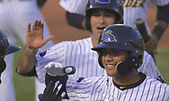 May 19, 2017 - Trenton, New Jersey, U.S - GLEYBER TORRES (foreground at right), an infielder for the Trenton Thunder, is congratulated by teammates when returning back to the dugout following his third-inning grand slam versus the Portland Sea Dogs at ARM & HAMMER Park. (Credit Image: © Staton Rabin via ZUMA Wire)