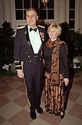 Chairman of the Joint Chiefs General Hugh Shelton and wife Carolyn arrive for the State Dinner for Argentine President Carlos Menem January 11, 1999 at the White House.