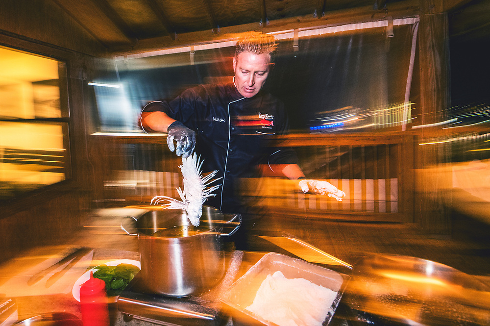 Chef Jim Shirah of Northern Florida prepares a plate of lionfish. Their white, flaky meat is often compared to grouper and snapper and is considered especially delicious. According to Jim, lionfish is one of their most popular dishes because they taste great and are guilt-free.