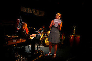 Casey Cyr performs with a jazz band led by David Amram while reading poetry and performing music at the Bowery Poetry Club during the 2007 Howl Festival in New York City.