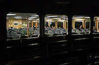 Ferry commuters ride across Puget Sound from Seattle to Bremerton at night, WA, USA