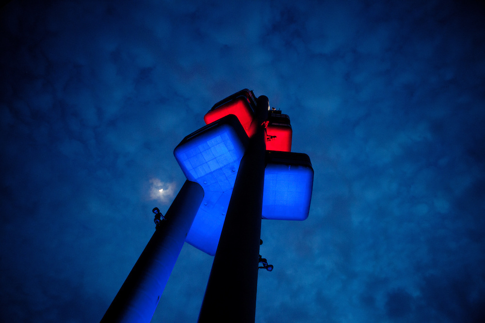 Evening view to the colorful Zizkov television tower located in Prague 3 - Zizkov. Sculptures of crawling babies by Czech artist David Černý are having a permanent installation on the tower.