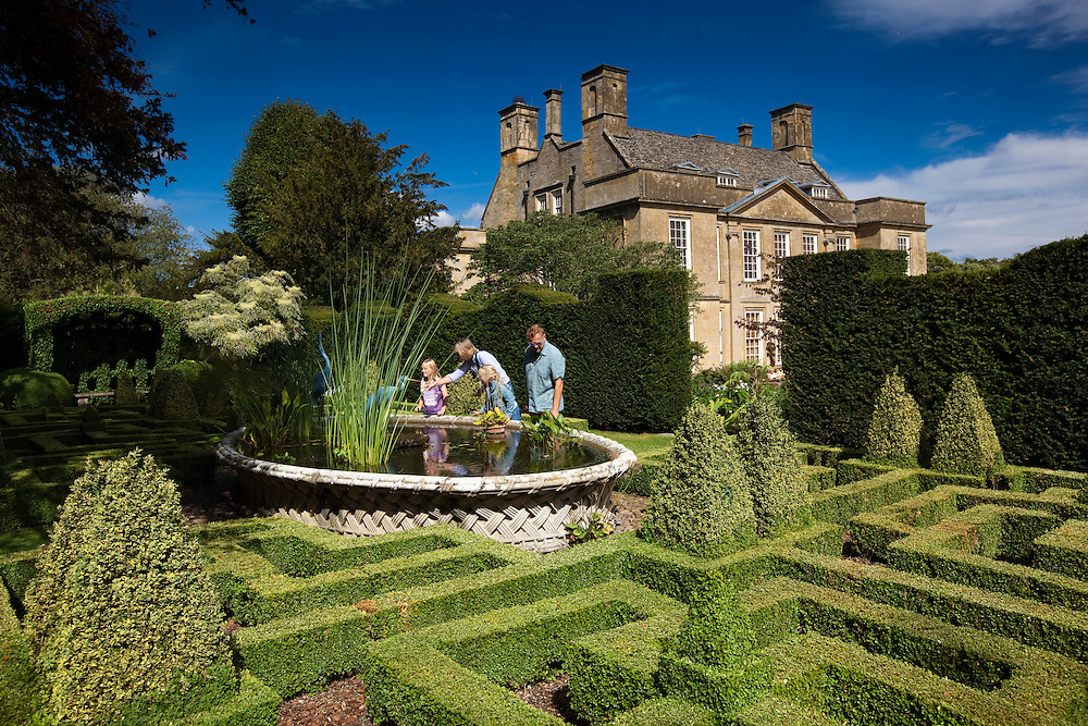 Family at Bourton House Garden, Gloucestershire, UK