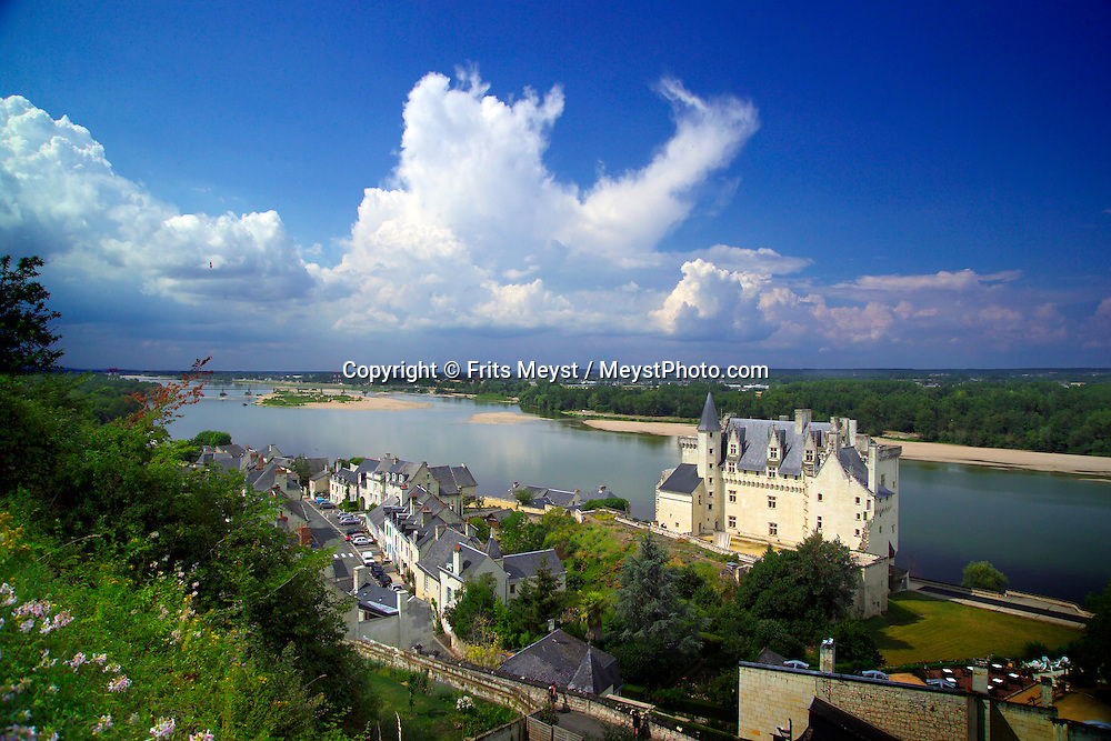 Tours, Loire, France, July 2006. Chateau Montsoreau overlooks the Loire. The best way to experience the Loire region is by bike. The 'Loire a Velo' trail leads through ancient villages with medieval castles, fields of wheat and sunflowers, vineyards and wine producers in the region. Photo by Frits Meyst/Adventure4ever.com