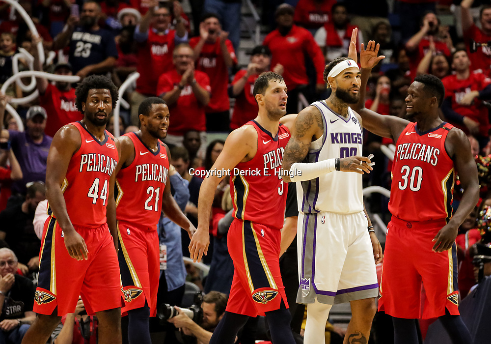 Oct 19, 2018; New Orleans, LA, USA; New Orleans Pelicans forward Nikola Mirotic (3) celebrates with forward Julius Randle (30) as he exits the game during the fourth quarter against the Sacramento Kings at the Smoothie King Center. The Pelicans defeated the Kings 149-129. Mandatory Credit: Derick E. Hingle-USA TODAY Sports