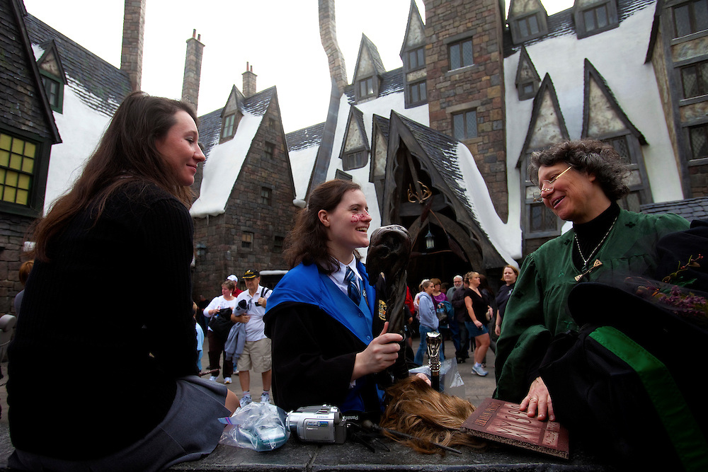 ORLANDO, FL -- January 5, 2011 -- Caitlin Wert, left, of Atlanta, Ga., her sister Erin, of Nashville, Tenn., and their mother Emily of Atlanta, Ga., dress as Harry Potter characters as they visit The Wizarding World of Harry Potter at Universal Orlando in Orlando, Fl., January 5.  The 20-acre park features a new ride inside the Hogwarts Castle and shops along the village of Hogsmeade - which has been packed with fans since its opening in June.