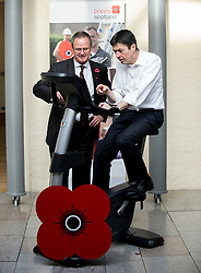 MSP's and staff from the Scottish Parliament hope to cycle the equivalent distance from Edinburgh to Glasgow to raise awareness for Poppy Scotland.<br /> <br />  Pictured: Scottish Parliament Presiding Officer Ken MacIntosh tests out the bike at the start of the challenge watched by Poppy Scotland Chief Executive Mark Bibbey.