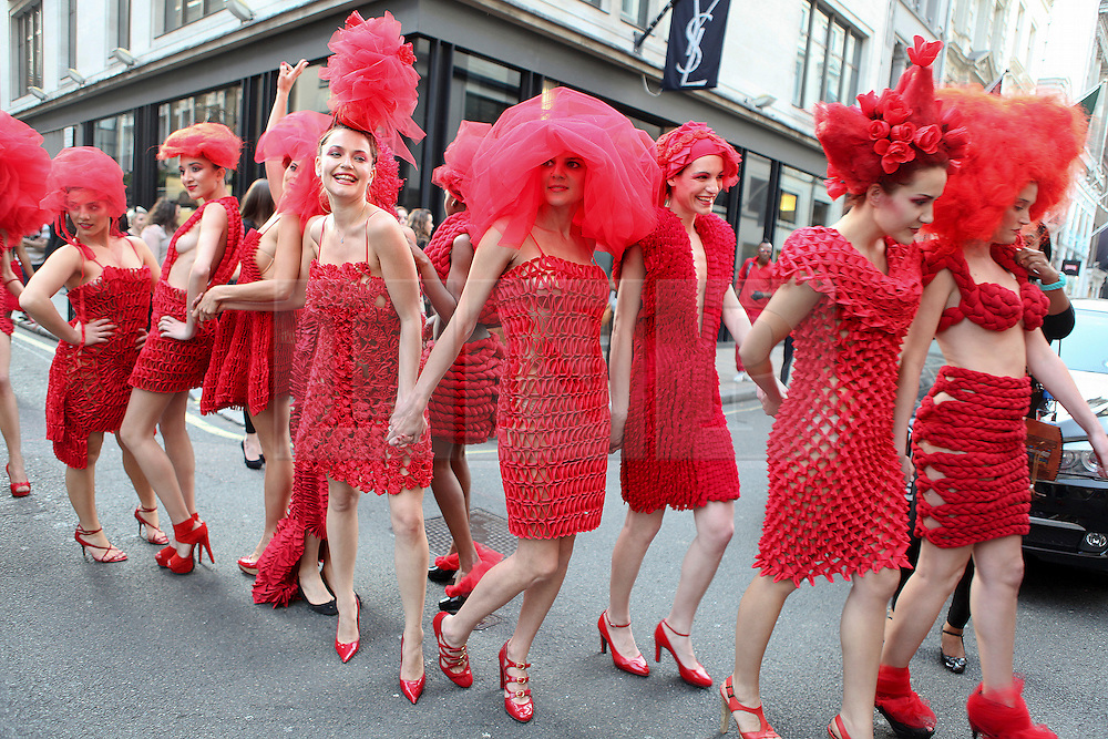 © licensed to London News Pictures. 21/04/2011. London, UK.  Haute Couture Pierre Garroudi flash mob fashion show in central London. 20 models presented Pierre Garroudi's red collection accompanied by dancers. See special instructions for usage rates. Photo credit should read Anton Phatianov/LNP..