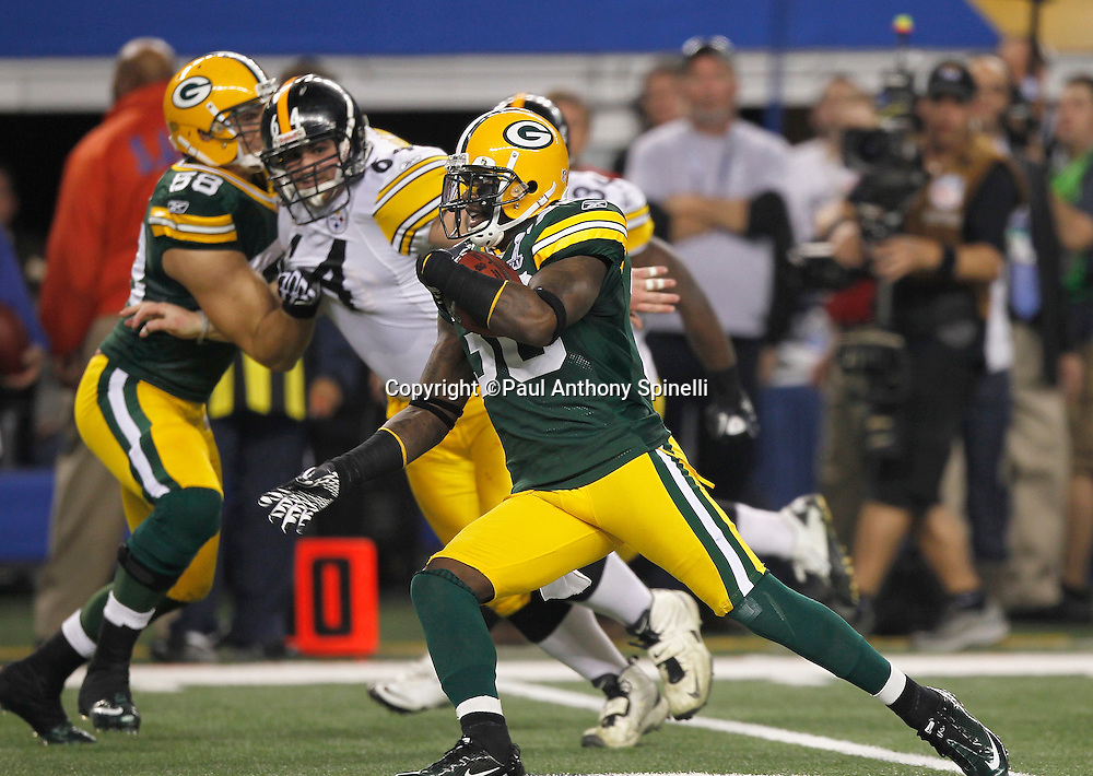 Green Bay Packers safety Nick Collins (36) picks off a first quarter pass and runs it back for touchdown and a 14-0 Packers lead during Super Bowl XLV against the Pittsburgh Steelers on Sunday, February 6, 2011, in Arlington, Texas. The Packers won the game 31-25. ©Paul Anthony Spinelli