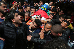 April 26, 2018 - Gaza, gaza strip, Palestine - Palestinian mourners carry the body of Palestinian journalist Ahmed Abu Hussein, while who was shot two weeks before by Israeli forces while covering demonstrations on the Gaza border, during his funeral in Jabalia in the northern Gaza Strip on April 26, 2018, after he succumbed to his injuries. (Credit Image: © Majdi Fathi/NurPhoto via ZUMA Press)