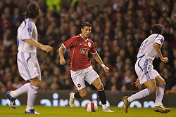 Manchester, England - Tuesday, March 13, 2007: Manchester United's Christiano Ronaldo in action against Europe XI's Roberto Ayala and Gianluca Zambrotta uring the UEFA Celebration Match at Old Trafford. (Pic by David Rawcliffe/Propaganda)