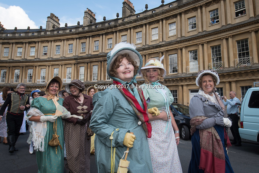 Bath, Somerset, UK. 9th September 2017. Pictured: THe Promenade passes through the world famous Georgian Circus. /  Around 600 people dressed in period attire take part in the Grand Regency Costumed Promenade in Bath marking the 200th anniversary of the English novelist Jane Austen's death. The Promenade commenced mid-morning from the world famous Royal Crescent Lawn and made its way through the historic Georgian streets and main shopping area of the city before finishing at Parade Gardens. In 2014 the Jane Austen Festival achieved the Guinness World Record TM for 'The largest gathering of people dressed in Regency costumes'. The Somerset city is currently host to the 17th annual Jane Austen Festival with an expected 4000 visitors taking part in events such as film screenings, book readings, workshops, dances, balls, talks, concerts and theatricals. // Lee Thomas, Tel. 07784142973. Email: leepthomas@gmail.com  www.leept.co.uk (0000635435)