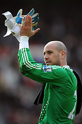 Pepe Reina celebrates towards the Liverpool fans after the final whistle of the Barclays Premier League match between Manchester United and Liverpool at Old Trafford on March 14, 2009 in Manchester, England.