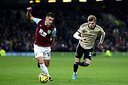 Burnley midfielder Ashley Westwood (18) and Manchester United defender Brandon Williams (53) during the Premier League match between Burnley and Manchester United at Turf Moor, Burnley, England on 28 December 2019.