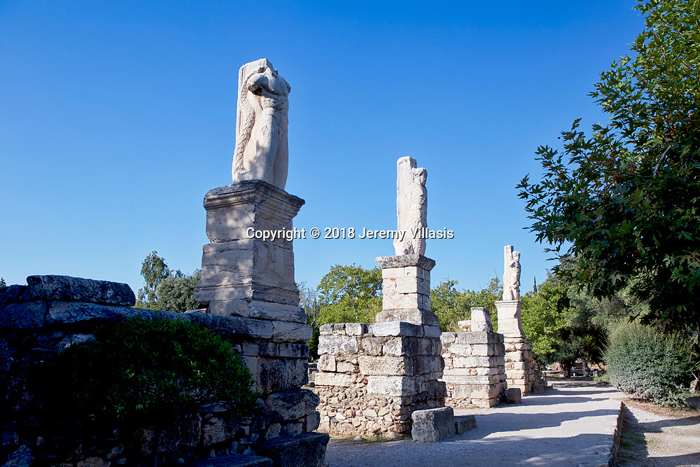 Statues of Triton and Giants at the Atrium of the Odeion of Agrippa, a Roman addition to the Ancient Agora of Athens in Greece.<br /> <br /> Built around 15 BC, the Odeion was a large concert hall located in the centre of the Ancient Agora.