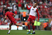 Liverpool midfielder Fabinho (3) and Liverpool forward Mohamed Salah (11) warming up during the Premier League match between Liverpool and Newcastle United at Anfield, Liverpool, England on 14 September 2019.